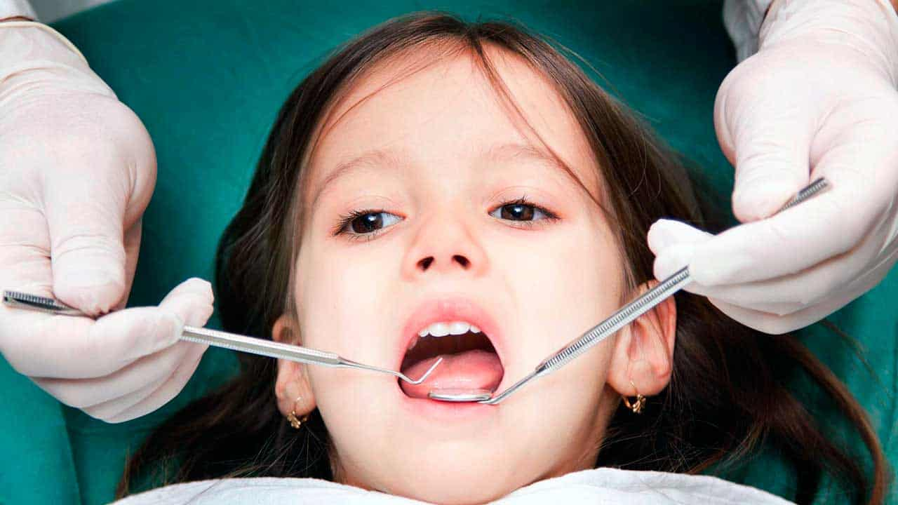 A girl during children's dental check-up at King of Prussia Dental Associates.