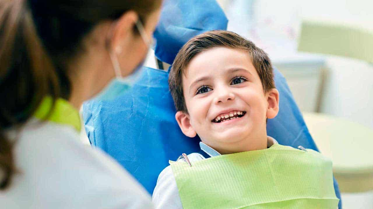 A child during pediatric dentistry consultation at King of Prussia Dental Associates.