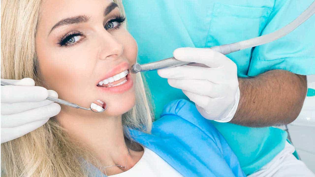 A patient getting porcelain veneers at King of Prussia Dental Associates.